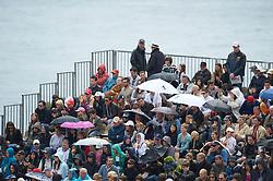 MONTE-CARLO, MONACO - Saturday, April 17, 2010: Spectators shield from the drizzling rain during the Men's Singles Semi-Final on day six of the ATP Masters Series Monte-Carlo at the Monte-Carlo Country Club. (Photo by David Rawcliffe/Propaganda)