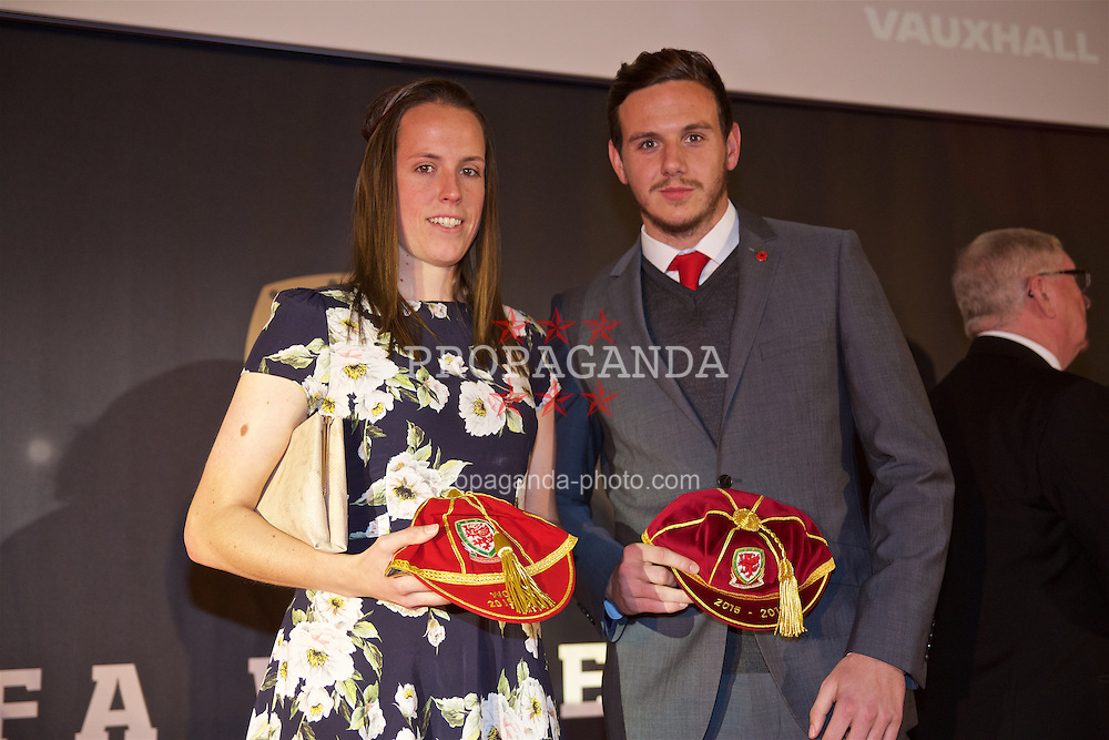 CARDIFF, WALES - Tuesday, November 8, 2016: Laura O'Sullivan and goalkeeper Daniel Ward with their caps during the FAW Awards Dinner at the Vale Resort. (Pic by David Rawcliffe/Propaganda)
