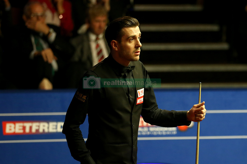 Mark Selby speaks with referee Jan Verhaas on day seventeen of the Betfred Snooker World Championships at the Crucible Theatre, Sheffield.