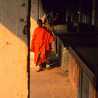 Monk walking in morning market, Muang Singh, Laos