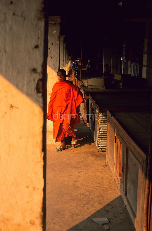 Monk walking in morning market, Muang Singh, Laos