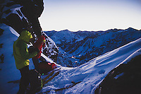 Caroline Gleich and Rob Lea transition from skinning to booting on wintery east ridge of Mt Superior in the early morning twilight, Wasatch Mountains.