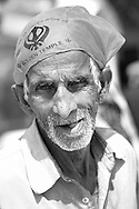 Black and white portrait of an aged man taken in Golden Temple of Amritsar, India