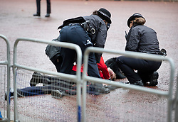 © Licensed to London News Pictures. 14/10/2019. London, UK. Police help a guardsman who fainted before Queen Elizabeth II rode down the The Mall to The Palace of Westminster for the State Opening of Parliament. Photo credit: Peter Macdiarmid/LNP