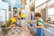 Alex Brake, 10, and Kirk Brake, 4, both of Sallisaw, Okla., play in a water feature at the Scott Family Amazeum on Friday, February 19, 2016, in Bentonville, Arkansas. Beth Hall for the New York Times