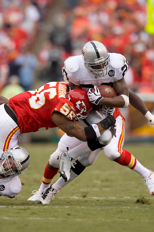 KANSAS CITY, MO - SEPTEMBER 14:   Darren McFadden #20 of the Oakland Raiders is tackled by Derrick Johnson #56 of the Kansas City Chiefs at Arrowhead Stadium on September 14, 2008 in Kansas City, Missouri.  The Raiders defeated the Chiefs 23-8.  (Photo by Wesley Hitt/Getty Images) *** Local Caption *** Darren McFadden; Derrick Johnson