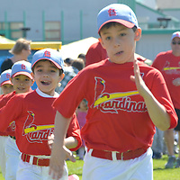 Baseball players run on to the field during Santa Monica P.O.N.Y. League's Opening Day Ceremony at Los Amigos Park on Saturday, March 3, 2012.