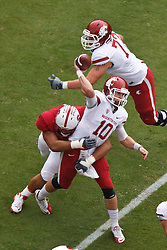 October 23, 2010; Stanford, CA, USA;  Washington State Cougars quarterback Jeff Tuel (10) is hit from behind while throwing by Stanford Cardinal defensive lineman Sione Fua (92) forcing an interception during the first quarter at Stanford Stadium.