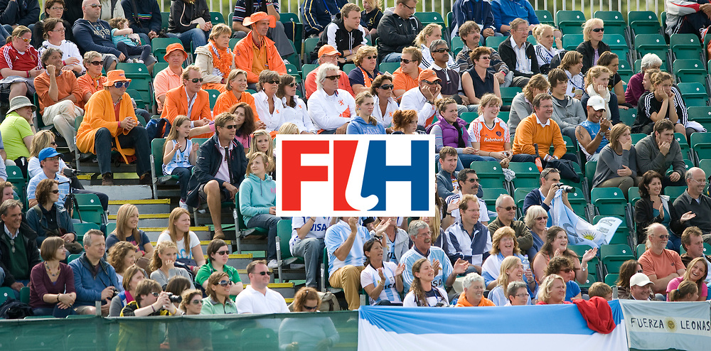 Dutch and Argentinian fans sit together during their Women's Champions Trophy Final at Highfields, Beeston, Nottingham, 18th July 2010.