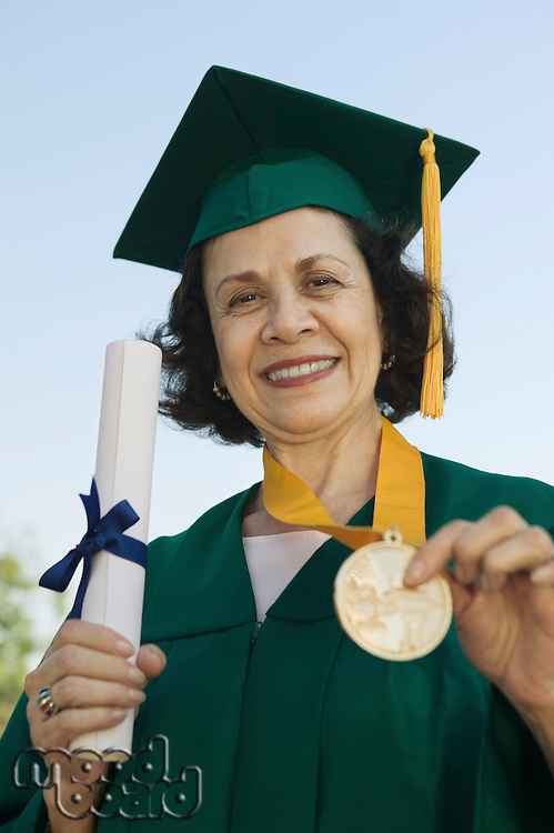 Graduate Holding Medal and Diploma