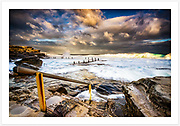 A dramatic late afternoon sky and big waves at Mahon Pool, Maroubra in Sydney's south-east [Maroubra, NSW, Australia].<br />