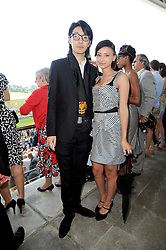 LEAH WELLER and TOMO KURATA at the Investec Ladies Day at Epsom Racecourse, Surrey on 4th June 2010.
