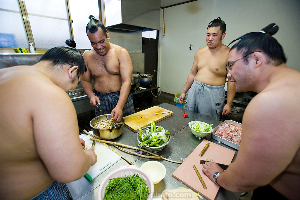 Wrestlers of the Professional Sumo Team (Musahigawa Beya): the members of Miyabiyama's Sumo Team cook and eat together while practicing for a tournament in Nagoya. The younger ones do most of the work. Sumos cook and eat chanko nabe, a stew pot of vegetable and meat or fish, at nearly every meal. It  is eaten with copious amounts of rice and numerous side dishes. Miyabiyama eats now to maintain his weight rather than to gain it, unlike the younger less gargantuan wrestlers in his stable who are eating a lot to pack on weight.