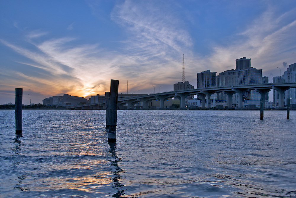 View of Sunset over Biscayne bay In Miami, also view of Julia Turtle Causeway and the Carnival Center of Performing Arts.