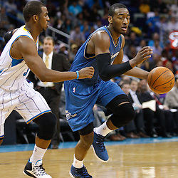 February 1, 2011; New Orleans, LA, USA; Washington Wizards point guard John Wall (2) drives past New Orleans Hornets point guard Chris Paul (3)during the third quarter at the New Orleans Arena. The Hornets defeated the Wizards 97-89.  Mandatory Credit: Derick E. Hingle