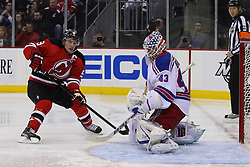 Jan 31; Newark, NJ, USA; New York Rangers goalie Martin Biron (43) makes a save on New Jersey Devils left wing Zach Parise (9) during the second period at the Prudential Center.