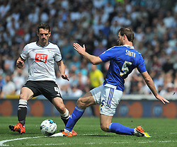 IPSWICH TOMMY SMITH HOLDS OF DERBYS CRAIG BRYSON, Derby County v Ipswich Town Championship, IPro Stadium, Saturday 7th May 2016. Photo:Mike Capps