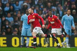 MANCHESTER, ENGLAND - Sunday, January 8, 2012: Manchester United's Wayne Rooney celebrates scoring the first goal against Manchester City's goalkeeper Costel Pantilimon during the FA Cup 3rd Round match at the City of Manchester Stadium. (Pic by David Rawcliffe/Propaganda)