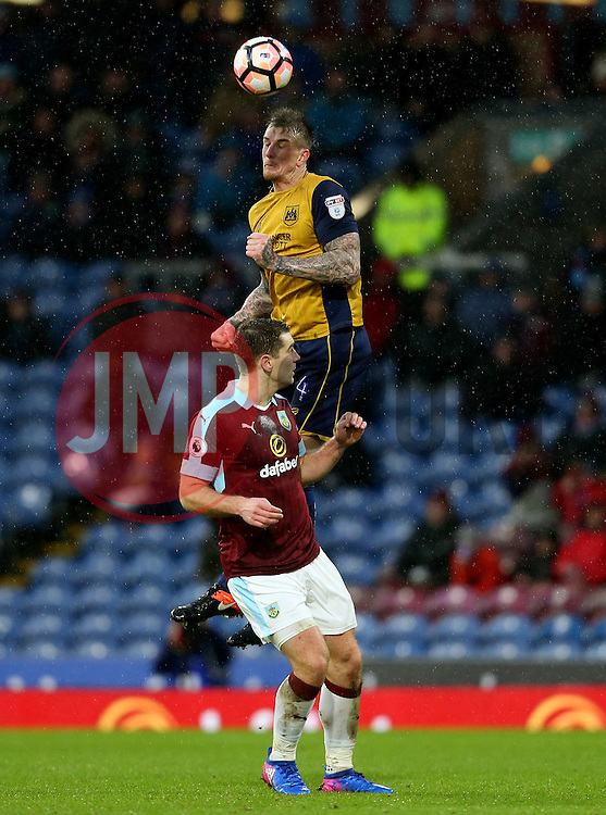Aden Flint of Bristol City wins a header above Sam Vokes of Burnley - Mandatory by-line: Matt McNulty/JMP - 28/01/2017 - FOOTBALL - Turf Moor - Burnley, England - Burnley v Bristol City - Emirates FA Cup fourth round
