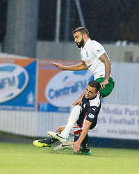 Falkirk's Tom Taiwo in on Hibernian's Liam Fontaine.<br /> haft time ; Falkirk 0 v 0 Hibernian, Scottish Championship game played 6/12/2014 at The Falkirk Stadium .