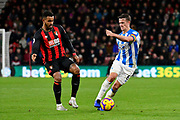 Joshua King (17) of AFC Bournemouth and Jonathan Hogg (6) of Huddersfield Town battles for possession during the Premier League match between Bournemouth and Huddersfield Town at the Vitality Stadium, Bournemouth, England on 4 December 2018.