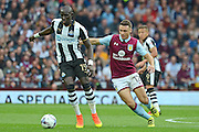 Aston Villa defender James Chester (12) tracks down Newcastle United midfielder Mohamed Diame (15) during the EFL Sky Bet Championship match between Aston Villa and Newcastle United at Villa Park, Birmingham, England on 24 September 2016. Photo by Alan Franklin.