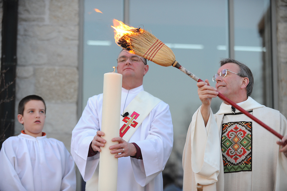 Norbertine Fr. Tim Shillcox lights the Easter candle outside of Our Lady of Lourdes Church in De Pere, Wis., during the Easter Vigil. (Sam Lucero photo)