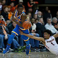 UCLA 's Aaron Holiday, left, steals the ball from Oregon State's Stephen Thompson Jr. (1) during the second half of an NCAA college basketball game in Corvallis, Ore., Friday, Dec. 30, 2016. UCLA won 76-63. (AP Photo/Timothy J. Gonzalez)