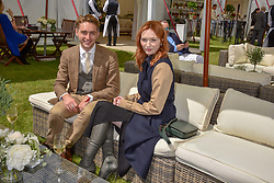 Eleanor Tomlinson and Ross Tomlinson at the Cartier Queen's Cup Polo 2019 held at Guards Polo Club, Windsor, Berkshire. UK 16 June 2019. <br /> <br /> Photo by Dominic O'Neill/Desmond O'Neill Features Ltd.  +44(0)7092 235465  www.donfeatures.com