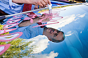 "13 OCTOBER 2010 - TUCSON, AZ: Terry Goddard paints ""Go Goddard"" on a car owned by one of his supporters at an event in Tucson. Goddard spent the day in Tucson campaigning. Goddard lost the election to sitting Governor Jan Brewer, a conservative Republican.     PHOTO BY JACK KURTZ"