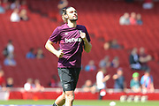 West Ham United striker Andy Carroll (9) warms up before the Premier League match between Arsenal and West Ham United at the Emirates Stadium, London, England on 22 April 2018. Picture by Bennett Dean.
