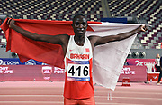John Koech (BRN) poses with flag after winning the steeplechase in 8:25.87 during the Asian Athletics Championships in Doha, Qatar, Saturday, April,21, 2019. (Jiro Mochizuki/Image of Sport)