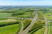 Nederland, Gelderland, Gemeente Zaltbommel, 23-08-2016; verkeersknooppunt Deil, A2 en A15 (vlnr). Parallel aan de A2 de Betuweroute, met goederentrein. Klaverturbineknooppunt.<br /> Deil junction, main motorway A15 (Rotterdam Harbour - Germany) crossing motorway A2 to the South.<br /> <br /> aerial photo (additional fee required); luchtfoto (toeslag op standard tarieven); copyright foto/photo Siebe Swart