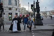 Pedestrians, Trafalgar Sq. London. 2 March 2016.