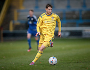 Gavin Rothery (Guiseley) runs with the ball during the Conference Premier League match between FC Halifax Town and Guiseley at the Shay, Halifax, United Kingdom on 5 December 2015. Photo by Mark P Doherty.
