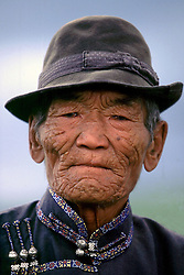 1999. Steppes, Mongolia. .A Mongolian elder at a Naadam festival..Photo; Charlie Varley