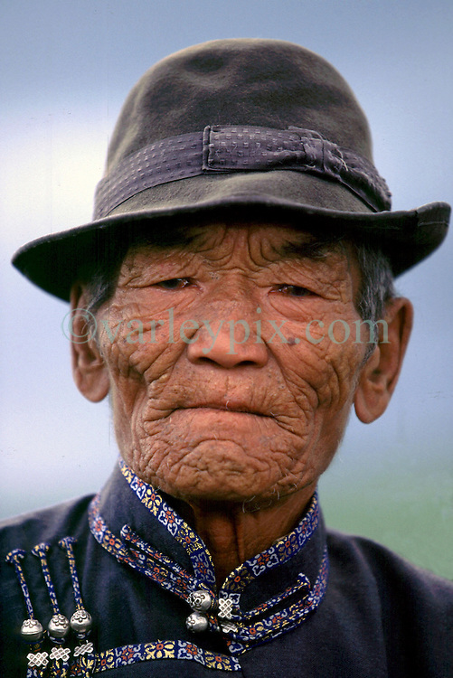 1999. Steppes, Mongolia. .A Mongolian elder at a Naadam festival..Photo; Charlie Varley