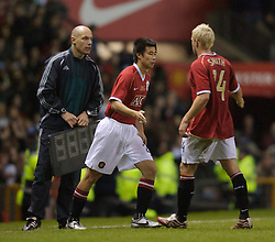 Manchester, England - Tuesday, March 13, 2007: Manchester United's Alan Smith is substituted by Dong Fangzhuo against a Europe XI during the UEFA Celebration Match at Old Trafford. (Pic by David Rawcliffe/Propaganda)
