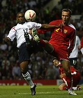 Photo: Paul Thomas.<br /> England v Macedonia. UEFA European Championships 2008 Qualifying. 07/10/2006.<br /> <br /> Jermain Defoe (L) of England battles with Nikolce Noveski.