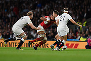 Wales back row Taulupe Faletau trying to evade tackles from England lock Joe Launchbury, England full back Richard Wigglesworth and England centre Sam Burgess during the Rugby World Cup Pool A match between England and Wales at Twickenham, Richmond, United Kingdom on 26 September 2015. Photo by David Charbit.