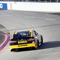 Erik Jones (20) races through turn three to practice  for the First Data 500 at Martinsville Speedway in Martinsville, Virginia.