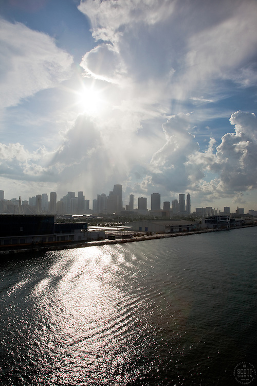 Miami with buildings, sun, and water.