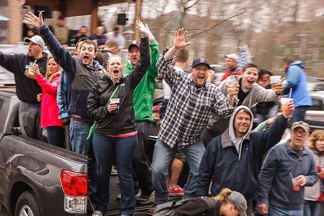 fans along race course in pickup truck cheer wildly