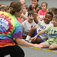P.J. Collier, center right, and Beckett Aycock play along with Julia Monts as she conducts storytime to area children at the Lee County Library Thursday.