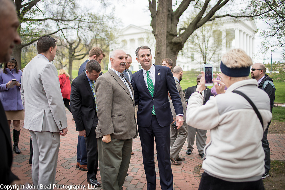 Former Monacan Chief, Ken Branham, left and Virginia Governor, Ralph Northam, following the dedication ceremony for Mantle: Virginia Indian Tribute, a monument designed on Virginia State Capitol Square, in Richmond, Virginia, on Tuesday, April 17, 2018. John Boal Photography