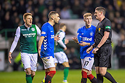 Eros Grezda (#35) and Ross McCrorie (#17) of Rangers FC appeal to referee Craig Thomson for handball during the Ladbrokes Scottish Premiership match between Hibernian and Rangers at Easter Road, Edinburgh, Scotland on 19 December 2018.