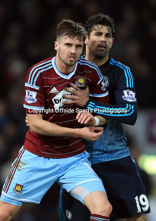 4 March 2015 - Barclays Premier League - West Ham United v Chelsea - Diego Costa of Chelsea tangles with Carl Jenkinson of West Ham - Photo: Marc Atkins / Offside.