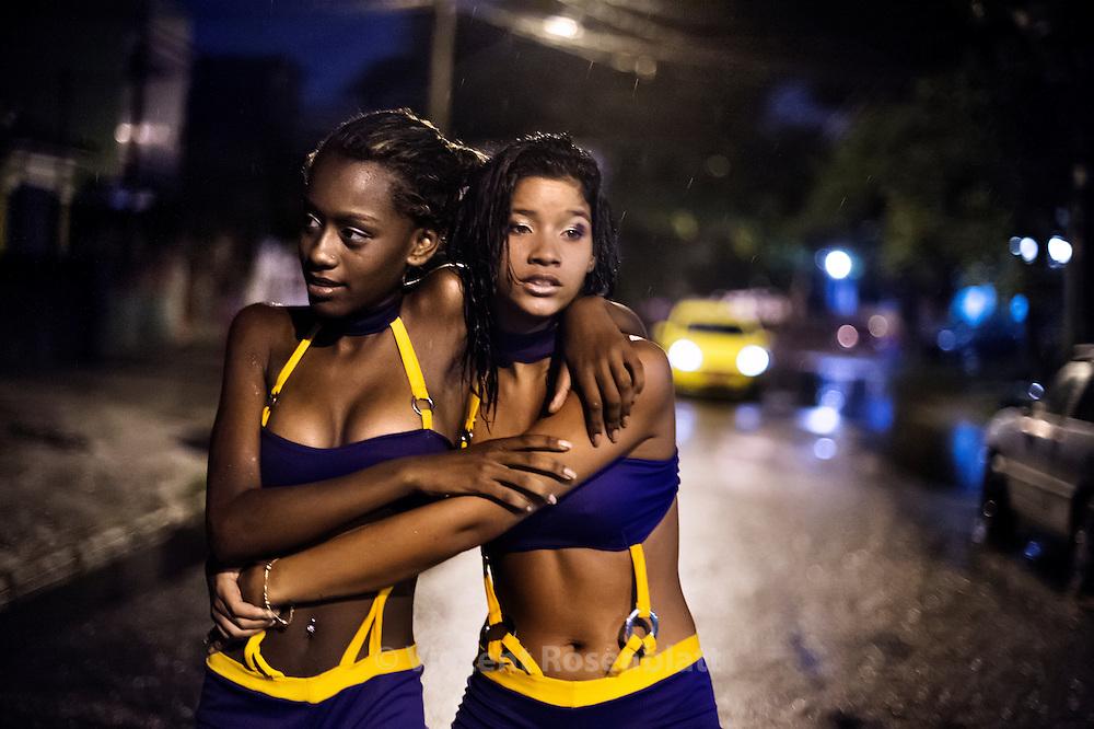 "Vanessa Kald , 14 and Suellen Santos, once dancers of the Desejadas girls band - before a show in the favela Acari, Zona Norte of Rio de Janeiro. // Vanessa Kald, 14 ans & Suellen Santos, 16 ans danseuses un temps du ""bonde"" (groupe) des Desejadas, avant un show dans la favela d'Acari, Zona Norte de Rio de Janeiro."
