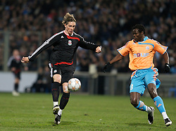 MARSEILLE, FRANCE - Tuesday, December 11, 2007: Liverpool's Fernando Torres and Olympique de Marseille's Taye Taiwo during the final UEFA Champions League Group A match at the Stade Velodrome. (Photo by David Rawcliffe/Propaganda)