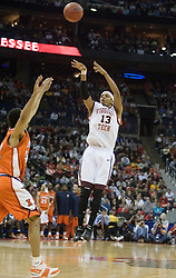 Virginia Tech Hokies forward Deron Washington (13) shoots over Illinois Fighting Illini forward Marcus Arnold (44).  The #5 seed Virginia Tech Hokies defeated the #12 seed Illinois Illini 54-52 in the first round of the Men's NCAA Tournament in Columbus, OH on March 16, 2007.